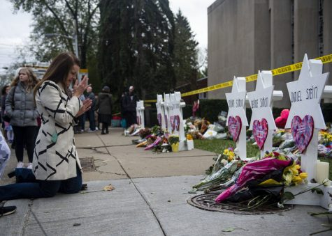 TREE OF LIFE SYNAGOGUE, PITTSBURGH, PENNSYLVANIA, UNITED STATES - 2018/10/29: A woman seen praying at the memorial service for the victims of the Tree of Life Massacre. Members of Pittsburgh and the Squirrel Hill community pay their respects at the memorial to the 11 victims of the Tree of Life Synagogue massacre perpetrated by suspect Robert Bowers on Saturday, October 27. (Photo by Matthew Hatcher/SOPA Images/LightRocket via Getty Images)