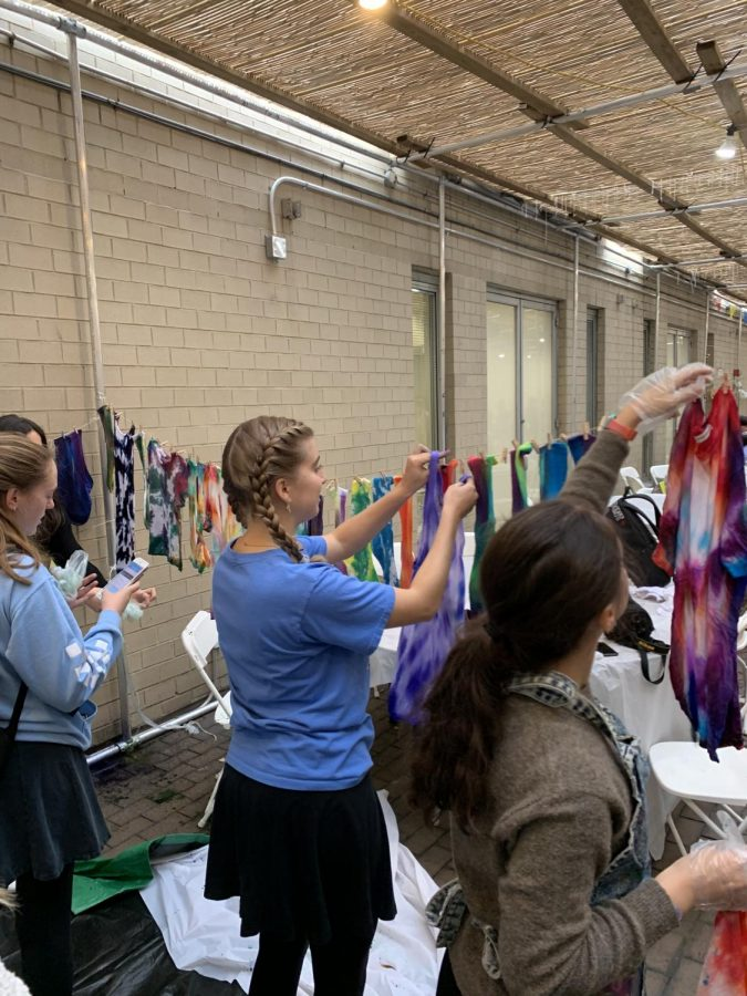 Students tie dying shirts in the Sukkah in 2019.